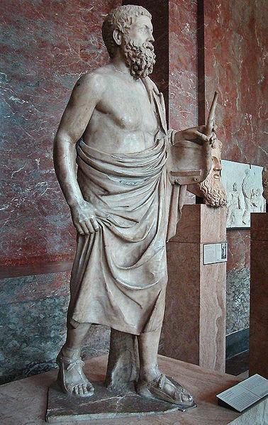 Pitagora di Reggio, statua di suonatore di lira. Copia romana del II secolo a.C., da un originale in bronzo del V secolo a.C. Marmo, 168 cm. Musée du Louvre, Parigi.