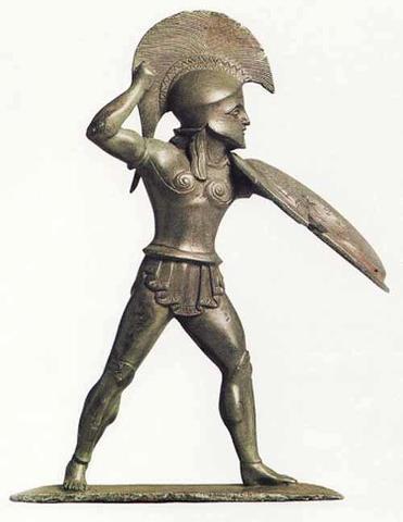 Oplita. Statuetta, bronzo, ultimo quarto del VI sec. a.C. ca. da una cista (?) presso il tempio di Zeus a Dodona (Epiro). Berlin, Antikensammlung.