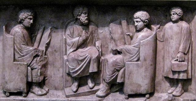 Scena di scuola. Rilievo, marmo, inizi III sec. d.C. ca. da Neumagen. Trier, Rheinisches Landesmuseum