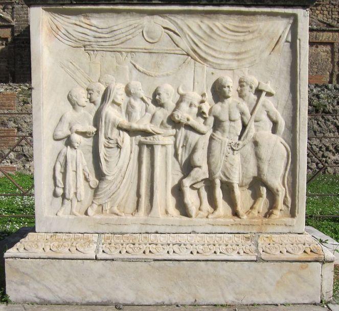 Scena di sacrificio. Bassorilievo, marmo, ante 79 d.C., dal Vespasianeum di Pompei.
