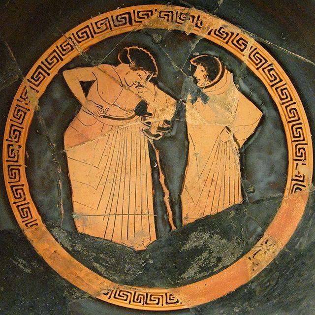Pittore di Castelgiorgio. Due giovani a colloquio. Pittura vascolare dal tondo di una kylix attica a figure rosse, 500-480 a.C. ca. Palermo, Museo Archeologico Regionale.