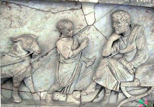 Ragazzo che recita la lezione al maestro. Sarcofago di M. Cornelio Stazio, rilievo, marmo, II sec. d.C. Paris, Musée du Louvre.